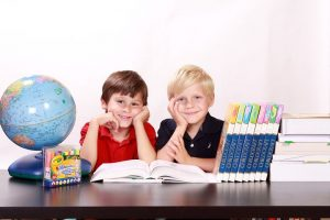 child care center with 2 boys, a globe and books